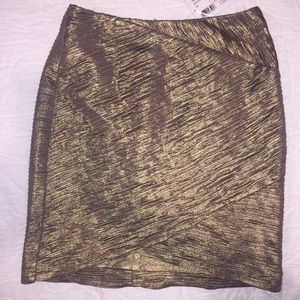 Gold mini skirt by Torn